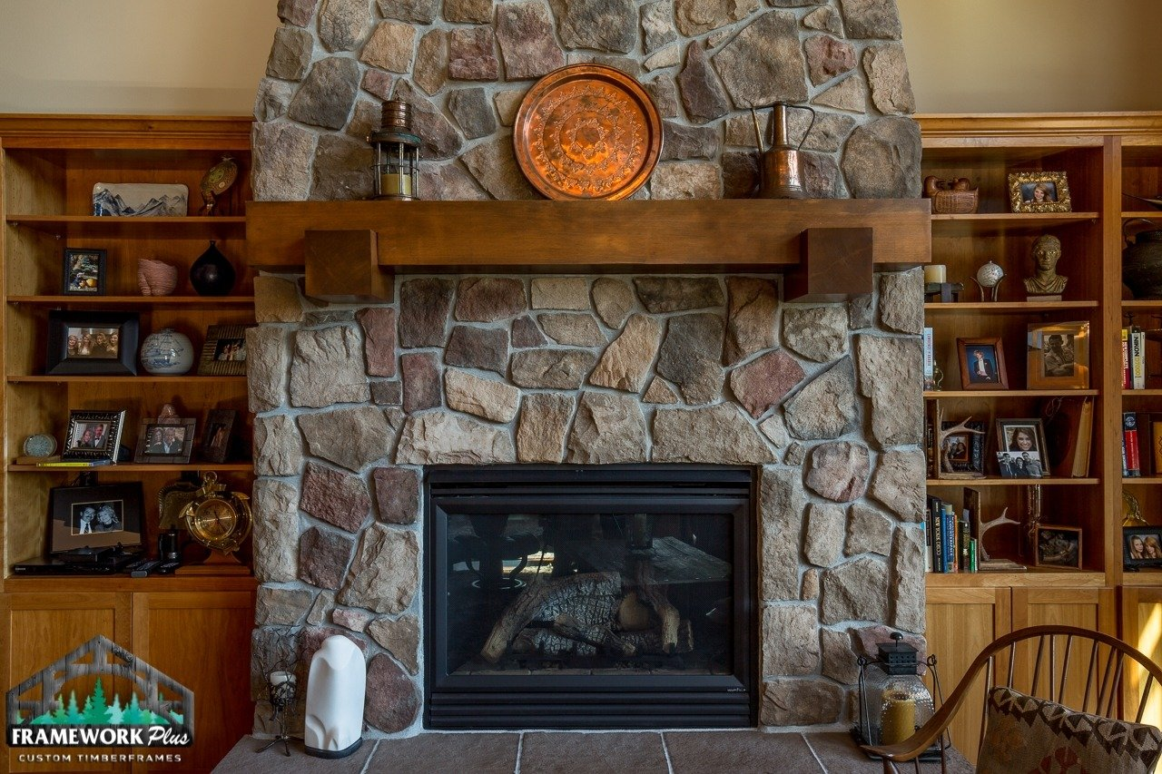 Mantel inside a home over fireplace front view